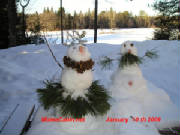 A pair of January Snowmen
